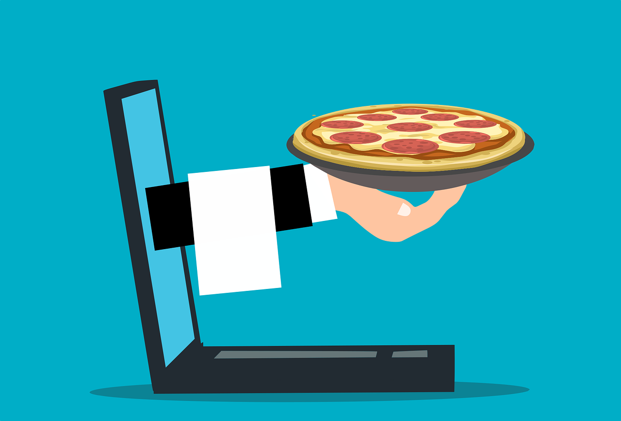 A pizza ordered online coming out of a computer